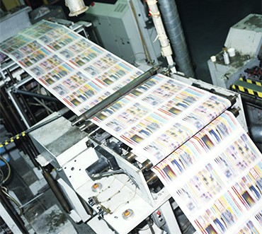 4 color process web press in factory, elevated view