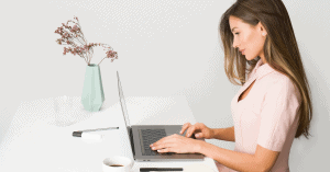 "Woman on a laptop; a featured image on LOJO Marketing's ""Website Redesign Guide - Updating Your Business Website Made Easy"""