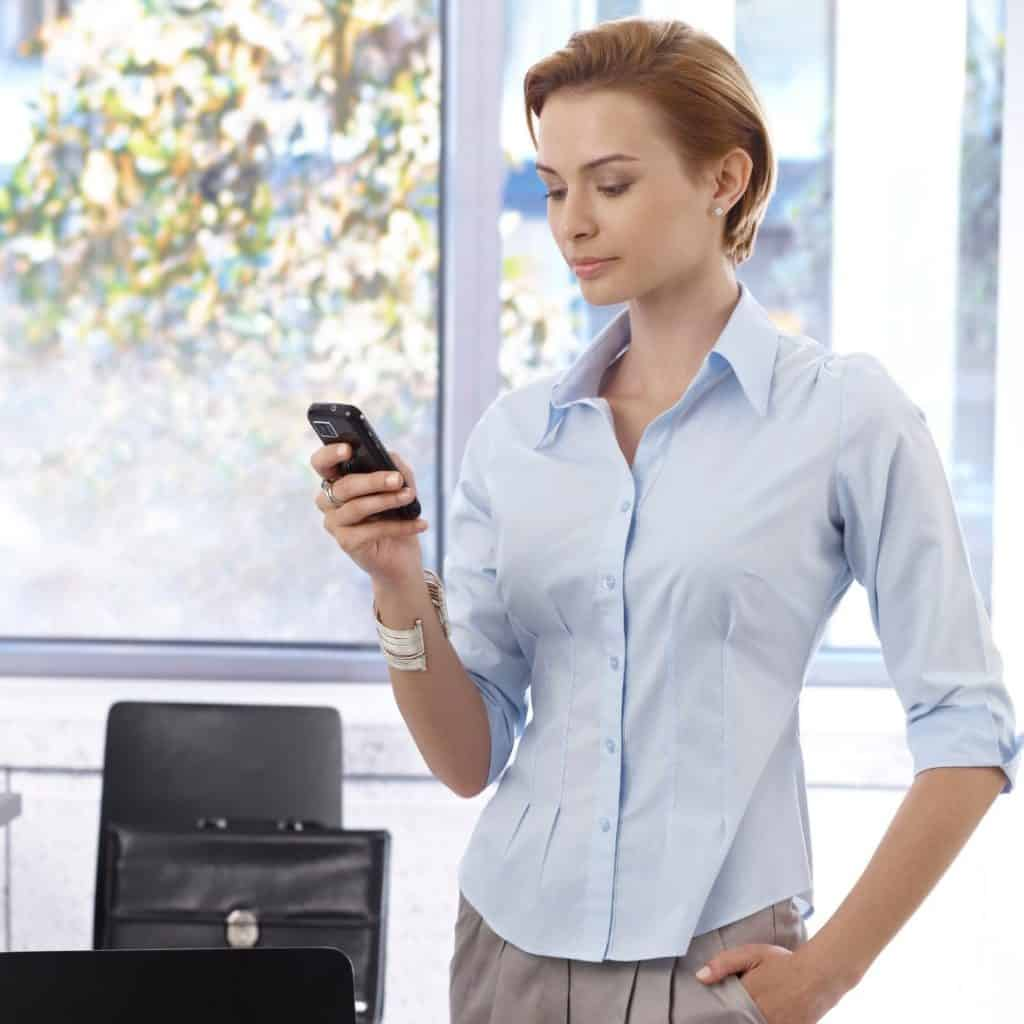 "An entrepreneur texting on her smartphone. A featured image from the LOJO Marketing article, ""Five Actionable Ways To More Effectively Promote Your Virtual Event""."