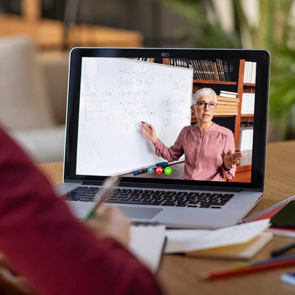 "An entrepreneur watching an online seminar from home. A featured image from the LOJO Marketing article, ""Five Actionable Ways To More Effectively Promote Your Virtual Event""."