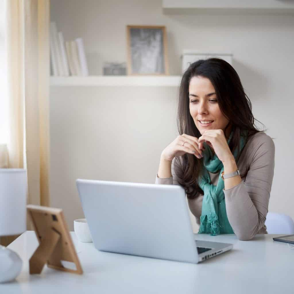 """An entrepreneur blogging on a laptop 