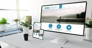 "A small business website rendered on desktop and a couple other smaller mobile devices | a featured image from ""8 Common Web Design Mistakes Many Business Owners Make (And How To Avoid Them)"", an article from LOJO Marketing."