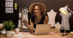 """An entrepreneur working on her online branding   a featured image from """"How Do I Build Trust Online (For My Brand)?""""   LOJO Marketing"""